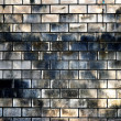 Ancient white brick wall with stain from flooding — Stock Photo