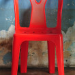 Old red plastic chair — Stock Photo #37795509