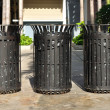 Three black iron bins — Stock Photo