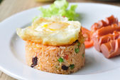 Fired rice with egg and sausages, mixing with pea, string bean — Stock Photo