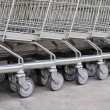 Row of empty shopping carts — Stock Photo #38317295