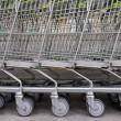 Row of empty shopping carts — Stock Photo #38317391