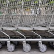 Row of empty shopping carts — Stock Photo #38317515