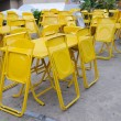 Yellow steel table sets with folding chairs. — Stock Photo #38317681