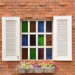 White window on red brick wall and color glass hang flowers pot — Stock Photo