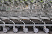 Row of empty shopping carts — Stock Photo