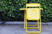Yellow steel table sets with folding chairs. — ストック写真