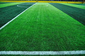 Line of artificial turf football field. — Stock Photo