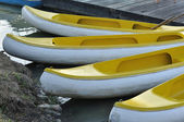Canoe boats floating — Stock Photo