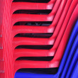Pattern from red and blue plastic chairs — Stock Photo