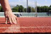 Runner starting action on racecourse — Stock Photo