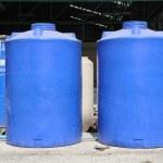 Big blue water plastic tank — Stock Photo #39401025