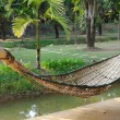 Old bamboo hammock hanging in garden. — Stock Photo