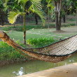 Old bamboo hammock hanging in garden. — Stock Photo #40115403