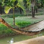 Old bamboo hammock hanging in garden. — Stock Photo