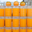Fresh oranges juices in jugs at market fair — Stock Photo #40125859
