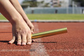 Relay-athletes hands starting action. — Stock Photo