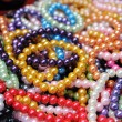 Many color bracelets in market fair, artificially — Stock Photo #42347565