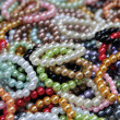 Many color bracelets in market fair, artificially — Stock Photo #42347629