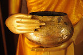 Statue Buddha holding monk  alms-bowl — Stock Photo
