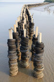 Wave barrier made from old tires — Stock Photo