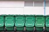 Green bins arrange out door — 图库照片