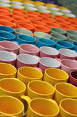 Colorful ceramic water mug — Stock Photo
