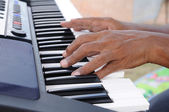 Man hand playing electone — Stock Photo