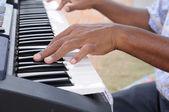 Hand playing keyboards — Stock Photo