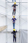 Unidentified workers on iron scaffolding — Stock Photo