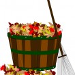 Pile of leaves in basket with rake — Stock Photo