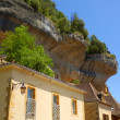 Limestone cliffs in Les Eyzies, Dordogne, France - Stock Photo