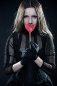 Gothic girl with lollipop — Stock Photo