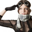 Prety pilot in scarf saluting over white — Stock Photo #17031315