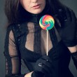Gothic girl with lollipop — Stock Photo #17033653