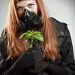 Redhead girl with plant — Stock Photo
