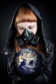 Girl holding earth — Stock Photo