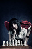 Pretty gothic with chess board — Stock Photo