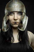 Pretty girl with roman helmet — Stock Photo