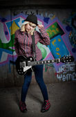 Teenager with guitar — Stock Photo