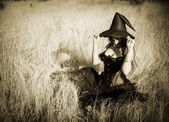 Witch in the field — Stock Photo