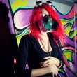 Redhead girl in gasmask — Stock Photo