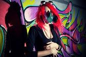 Redhead girl in gasmask — Stock Photo