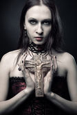 Gothic girl with crucifix — Stock Photo
