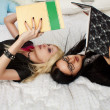 Two schoolgirls in bed — Stock Photo