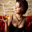 Glamour girl with wineglass — Stock Photo