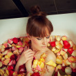 Bath full of rose petals — Stock Photo