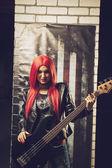Rocker with bass guitar — Stock Photo
