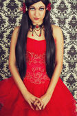 Doll in red — Stock Photo