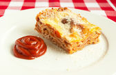 Portion of tasty lasagna on a plate — Stockfoto
